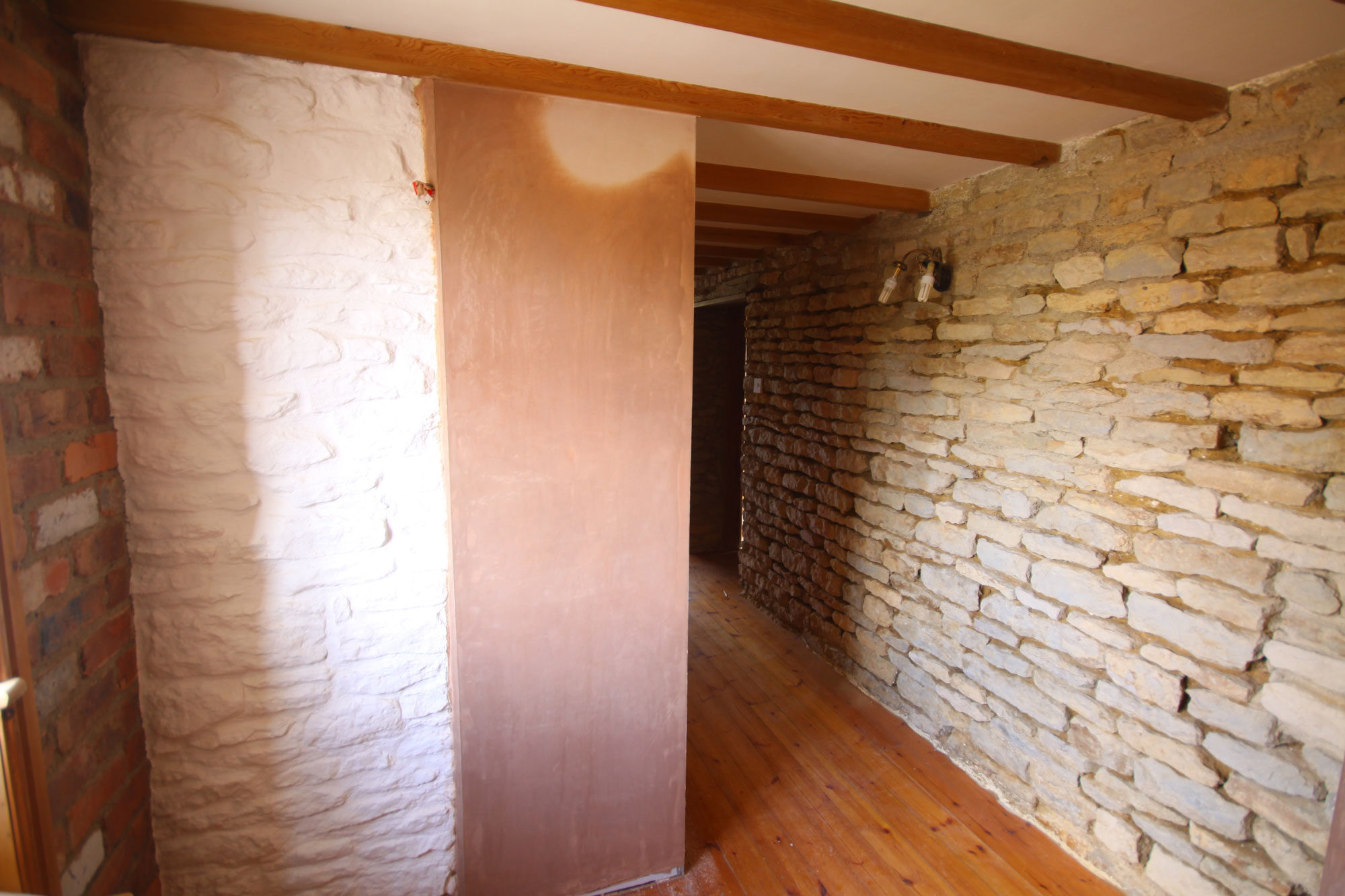 exposed-stone-plaster